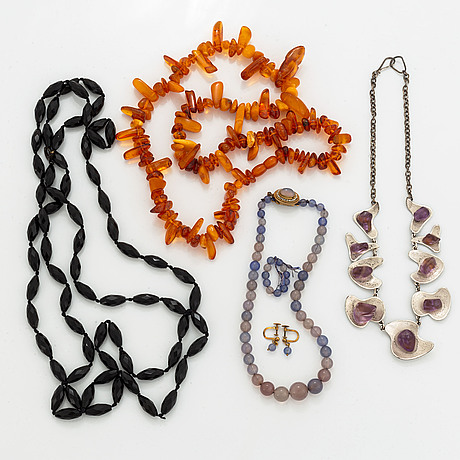 Amber, amethyst, chalcedony and faceted black stone necklaces and earrings.