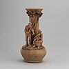 Giuseppe vaccaro caltagirone, a signed terracotta sculpture with vase.