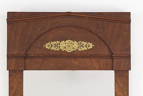 A mahogany empire mirror, first helf of the 19th century.