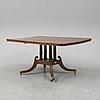 A mahogany dining table.