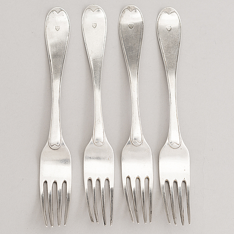 A set of four 18th-century silver dinner forks, mark of mikael nyberg, stockholm 1790-92.