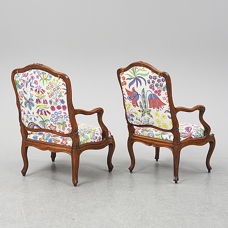 Two 18th century french louis xv walnut armchairs.