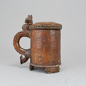 A 19th century painted wooden tankard.