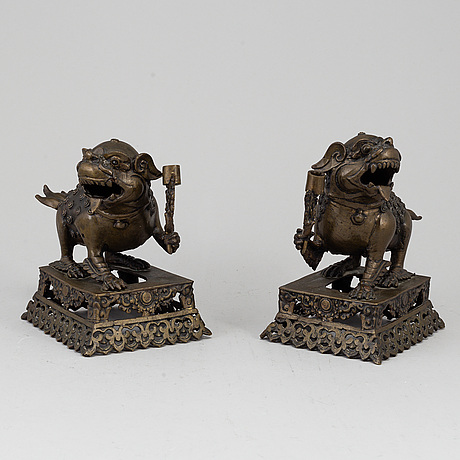 A pair of chinese bronze incense burners, 20th century.