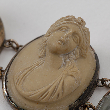Silver and lava cameo necklace and bracelet.