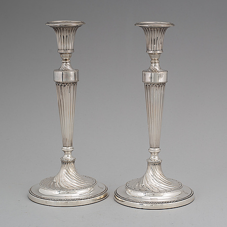 A pair of english 18th century silver candlesticks, unidentified makers mark, sheffield 1781.