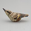 Tyra lundgren, a stoneware sculpture of a bird, signed.