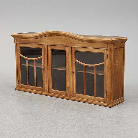 An early 20th century oak cabinet.