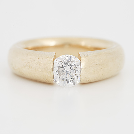 A brilliant cut diamond ring.