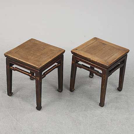 A pair of hardwood tables, 20th century.