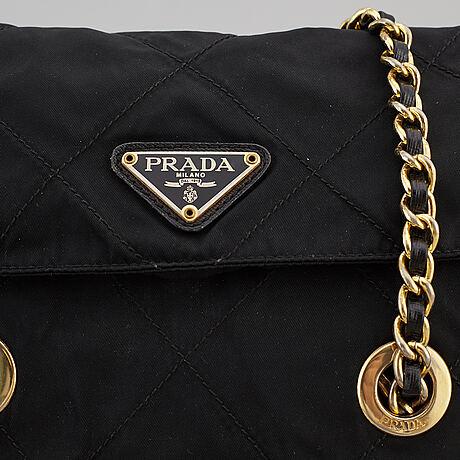 Prada, a quilted nylon bag.