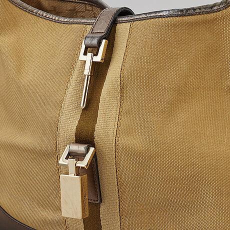 Gucci, a metallic bag.