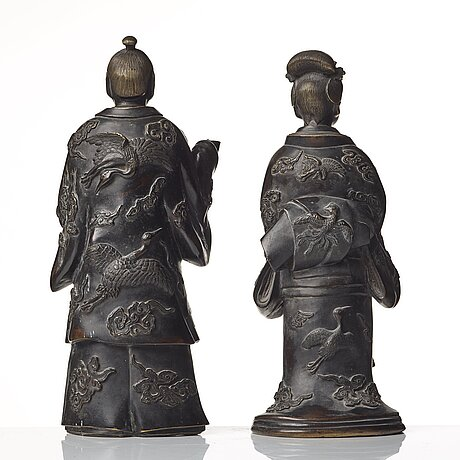Two standing japanese bronze sculptures of a samurai and bijin, edo period (1603-1868).
