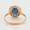An 18k gold ring set with a faceted sapphire weight ca 2.00 cts and old-cut diamonds.