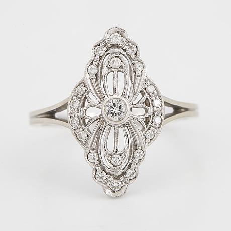 White gold and brilliant-cut diamond ring.