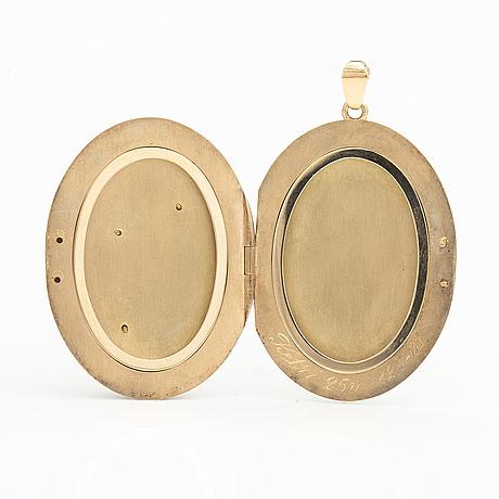 A 14k gold pendant/medallion with glass stones. kultakeskus.