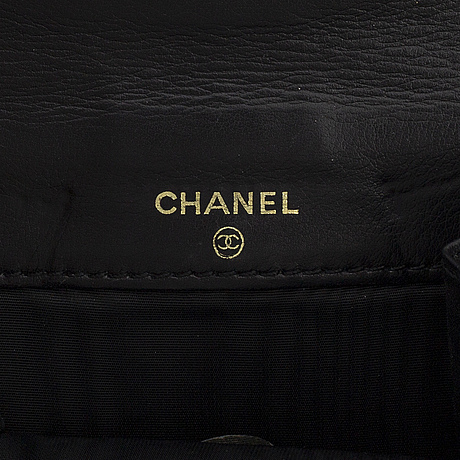 Chanel, a caviar leather wallet.