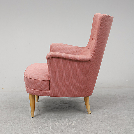 An easy chair by carl malmsten, second half of the th century.