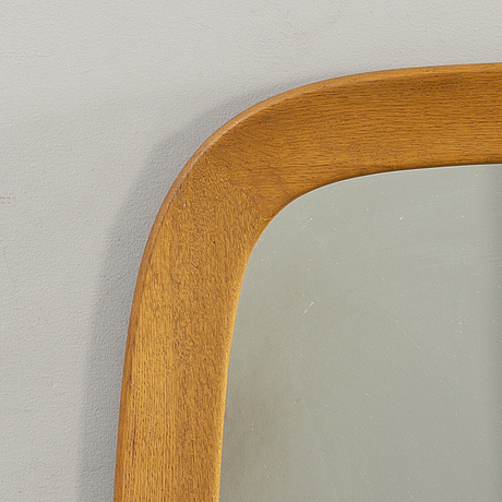 A wall mirror from frÖske mid 20th century.