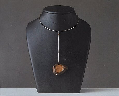 Vivianna torun bülow-hübe, a silver necklace with a beach stone pendant, executed in her own workshop in france, ca 1958-64.