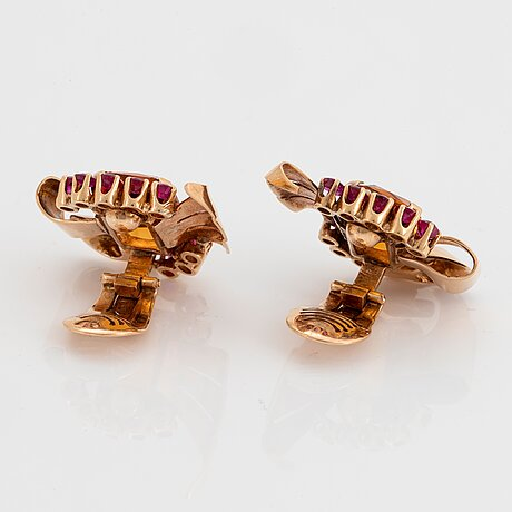 A pair of 18k gold earrings set with faceted citrine and rubies.
