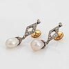 A pair of platinum and natural pearl earrings.