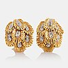 A pair of 18k gold earrings set with eight-cut diamonds.