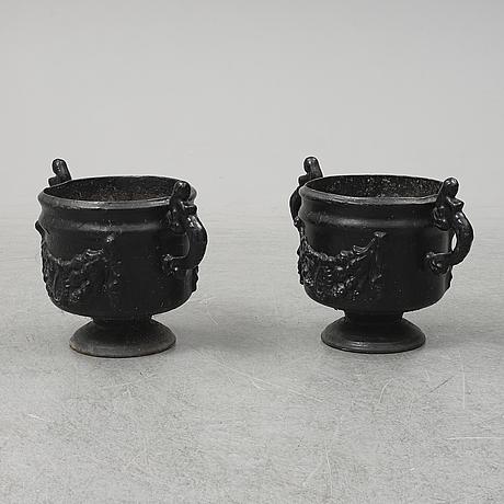 A pair of cast iron plant pots, stavsjö bruk.