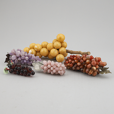 A group of five glass and stone objects, in shapes of fruits, 20th century.