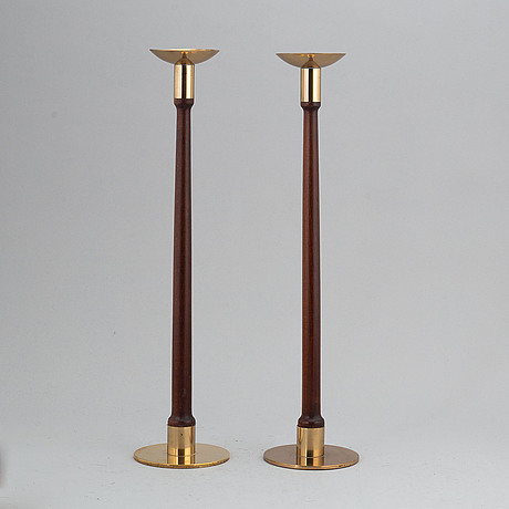 Hans-agne jakobsson, a pair of brass and teak candle holders, markaryd, mid 20th century.
