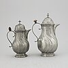 A pair of rococo style pewter coffee pots, from around year 1900.