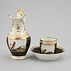 A porcelain jug and a cup with saucer, empire style, circa 1900.
