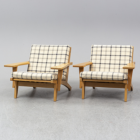 Hans j wegner, a pair of oak easy chairs, getama, denmark.