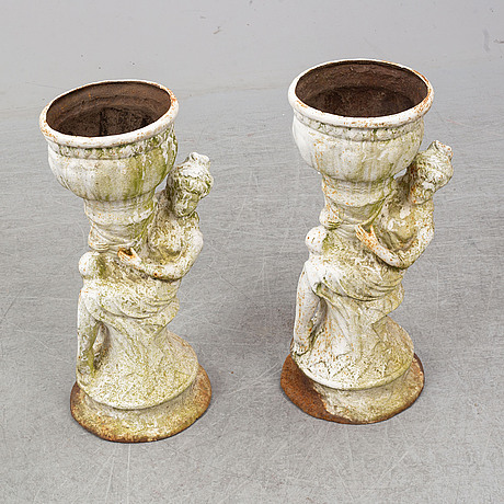An end of the 20th century pair of cast  iron flower pots.