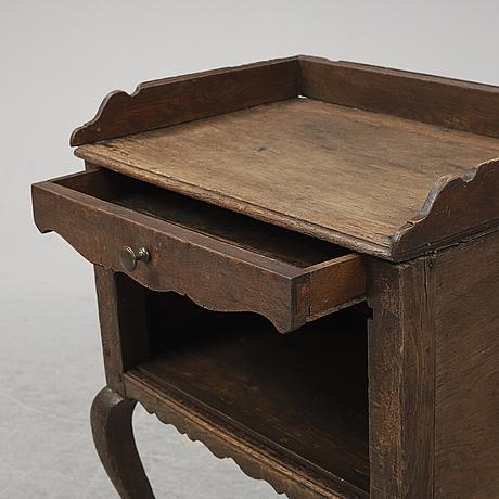 A mid 18th century oak rococo bedside table.
