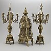 A 20th century set of a brass mantle clock and a pair of candelabras.