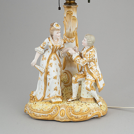 A rococo-style porcelain table lamp from the first half of the 20th century.