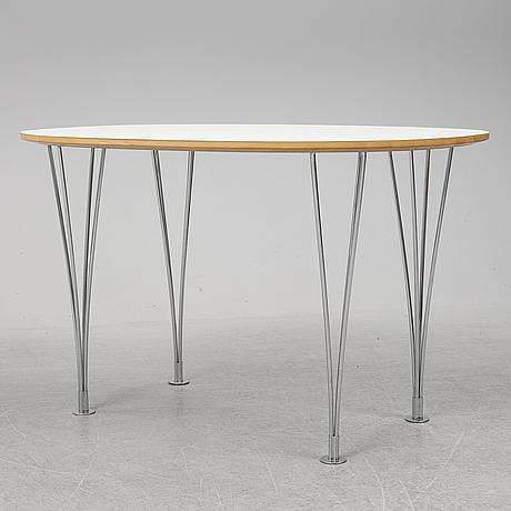 "A 'superellips"" table by bruno mathsson & piet hein for mathsson international darted 2011."