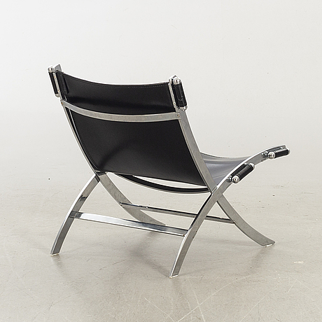 Paul tuttle for flexform lounge chair in chrome and black leather.