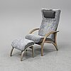 A 'delta adventure' easy chair with foot rest, brunstad, norge.