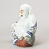 A chinese porcelain buddha, 20th century.