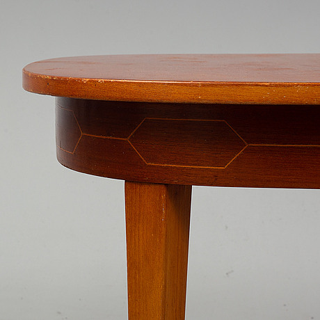 A mid 20th century mahogany dining table attributed to dag melin.