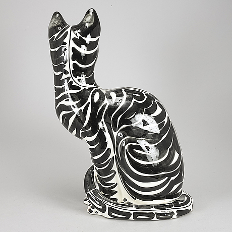A ceramic figure of a cat, italy, 1980's.