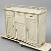 An early 19th century painted late gustavian cupboard.