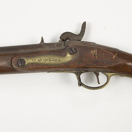A 18th century swedish-british converted percussion gun.