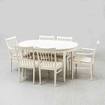 A second half of the 20th Century 'Herrgården' dining table with four chairs and two armchairs by Carl Malmsten.