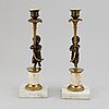 A pair of gustavian style candles sticks, circa 1900.