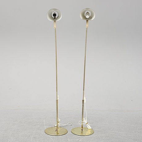 A pair of ikea floor lamps.