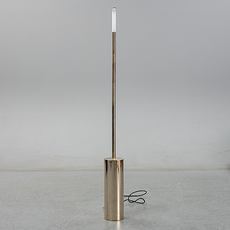 A contemporary 'parisienne' brass floor light from ozone light.