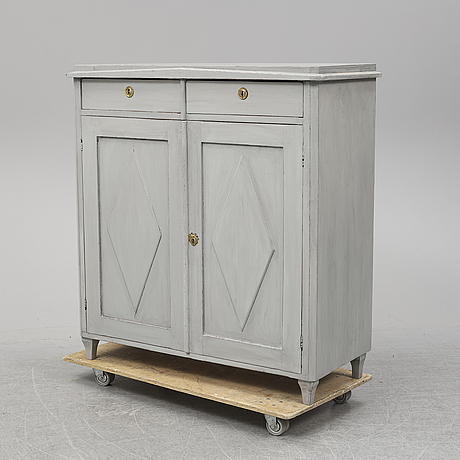 A mid 19th century painted cupboard.